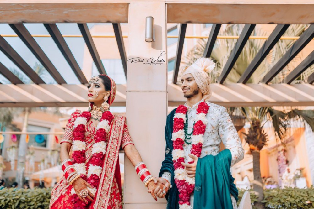 A wonderful Sikh wedding with bride in traditional red lehenga